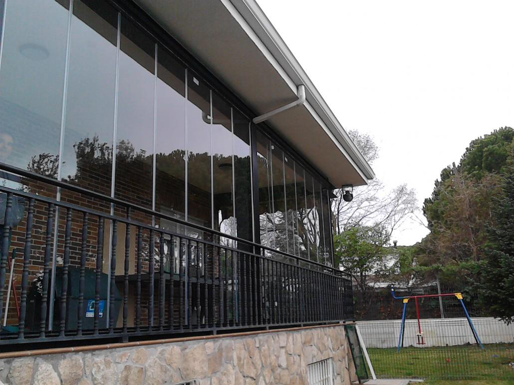instalación de cortina en porche urb Algete
